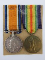 A pair of WWI British medals being War and Victory each with ribbon engraved for 58491 PTE.E.H.