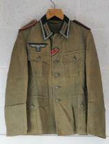 An rare WWII German Heeres Artillery or Gunnery NCO's summer tunic,