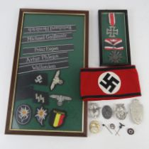 A quantity of assorted reproduction WWII German badges,
