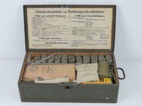 A WWII German Luftschutz First Aid box with accessories inc scissors, torniquet, gauze, GEW.