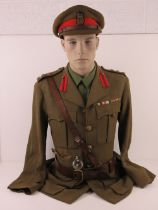 A British Army Brigadiers Royal Engineers service uniform with visor cap, Sam Brown belt,