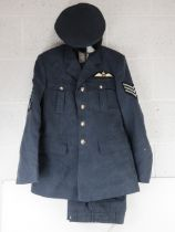 An RAF No1 Dress uniform with peaked cap, having cloth patches upon.