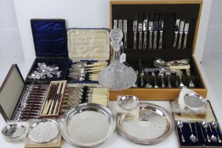 A large quantity of assorted silver plated and other cutlery including part set in wooden canteen,