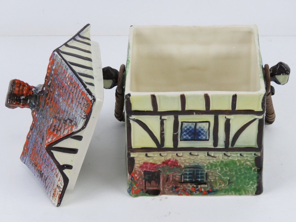 A hand painted ceramic wafer / biscuit barrel in the form of a beamed house 'Ye Olde Inne'. - Image 2 of 4