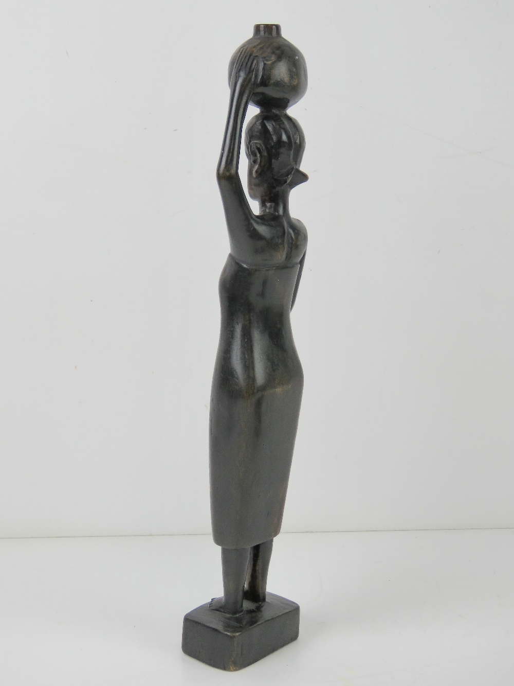 A carved African hardwood figurine of a woman standing 31cm high, - Image 3 of 4