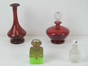 A ruby glass perfume bottle having clear glass stopper together with similar ruby glass vase,