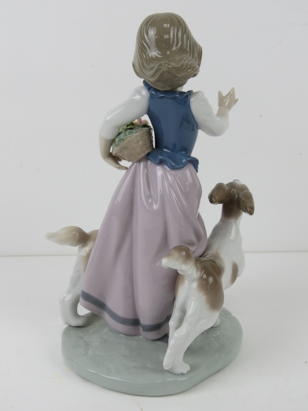 Lladro figurine 5761 'Out For A Romp' a girl with two dogs and a basket of flowers under her arm, - Image 3 of 5