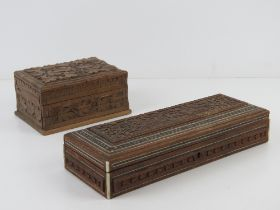 Two carved wooden boxes, 27 x 10cm and 15 x 10.5cm respectively.