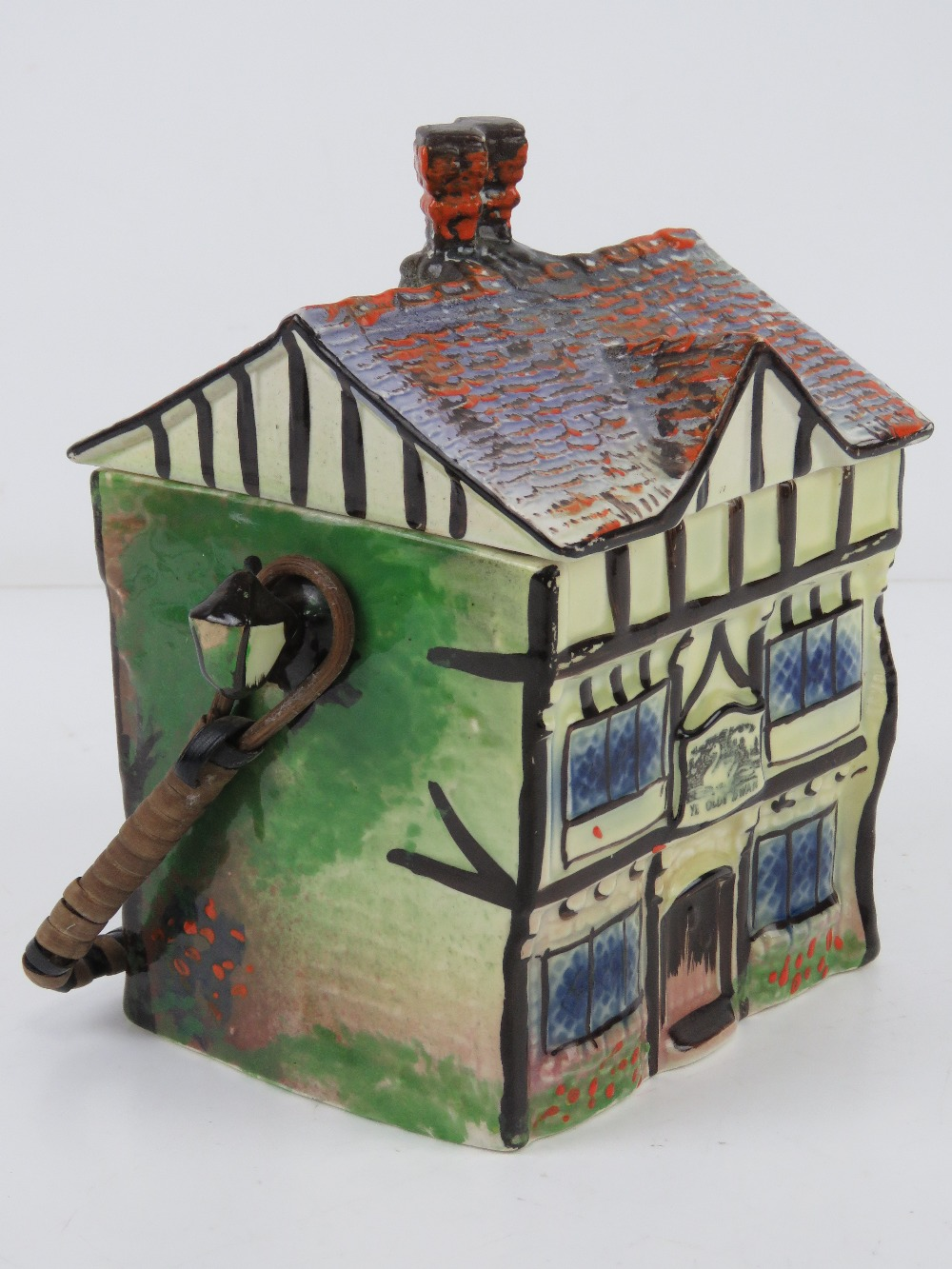 A hand painted ceramic wafer / biscuit barrel in the form of a beamed house 'Ye Olde Inne'. - Image 4 of 4