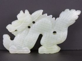 A carved celadon jade figure of a dragon, approx 11.5cm in length, 6.5cm high, 1.3cm wide, 127.5g.