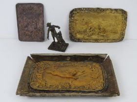 A pressed and gilded metal plate bearing two hares with foliate border, on a/f cardboard tray,