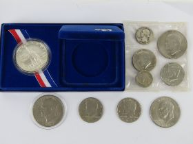 American coins and commemorative coins inc 1986 silver proof Libery Dollar (900 silver) 26.