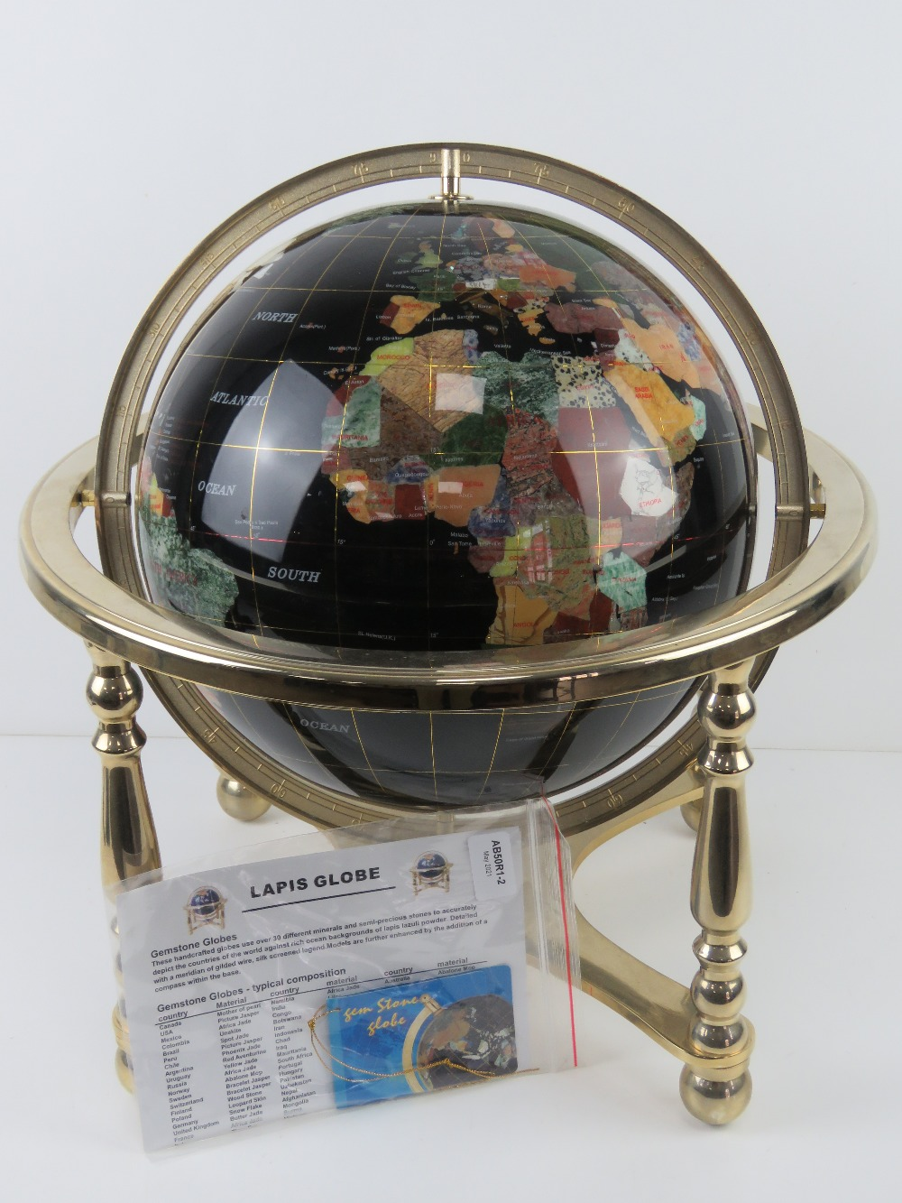 A 'Gemstone Globe' handcrafted with minerals and semi-precious stones including Lapis Lazuli powder