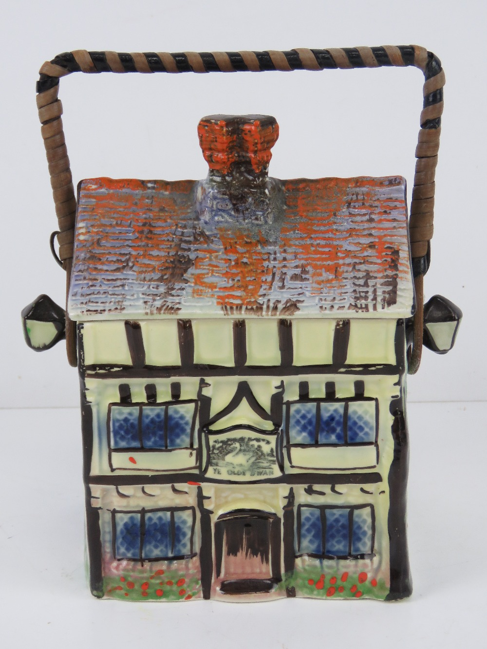 A hand painted ceramic wafer / biscuit barrel in the form of a beamed house 'Ye Olde Inne'.