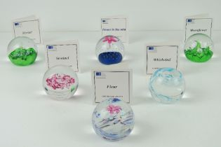 A set of six Royal Mint Classics limited edition Caithness glass paperweights,