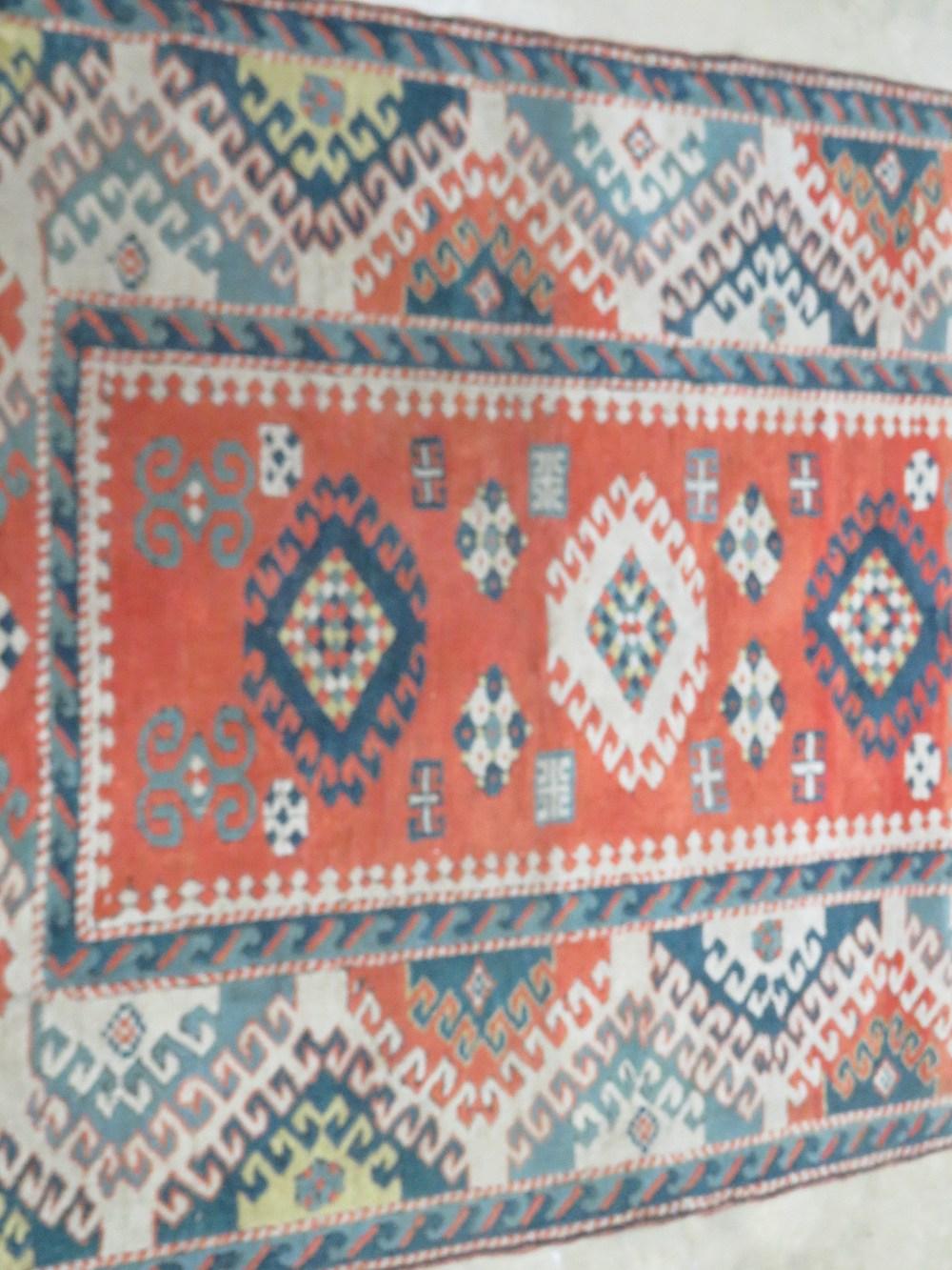 A teal and orange ground woollen rug hav - Image 2 of 2