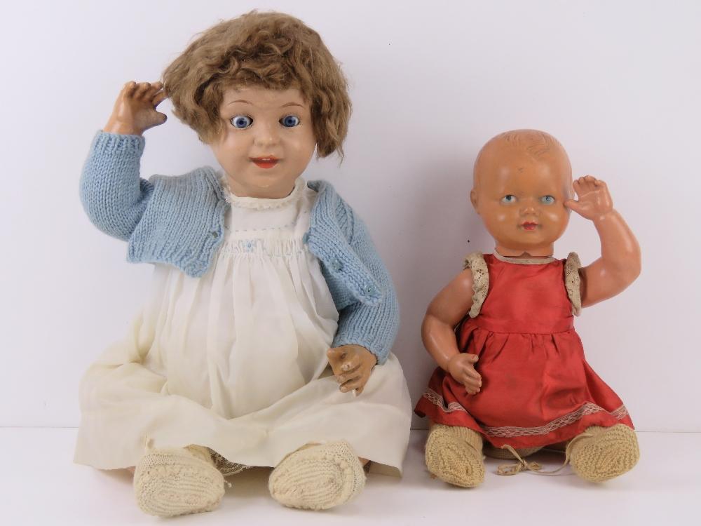 A vintage doll having glass eyes, handpa