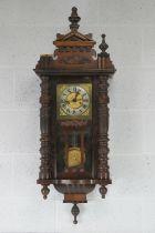 An early 20thC Vienna wall clock having