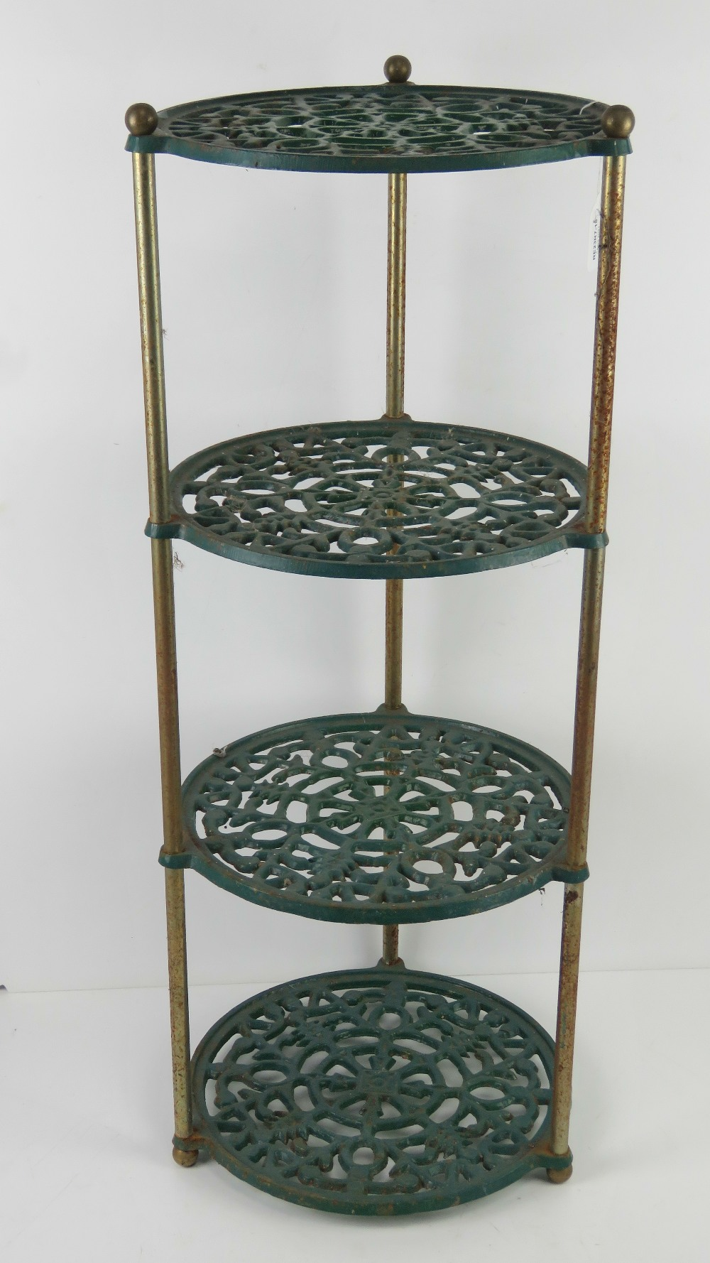 A green painted metal kitchen four tier