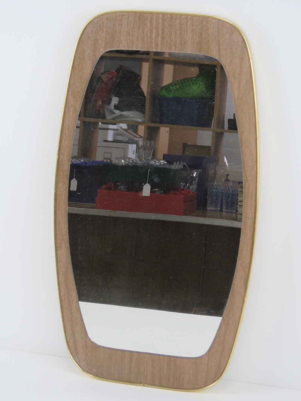 A c1960s wall mirror of geometric style