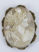 A large carved shell cameo of classical