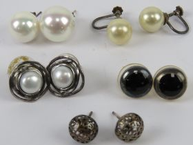 A pair of silver and pearl stud earrings