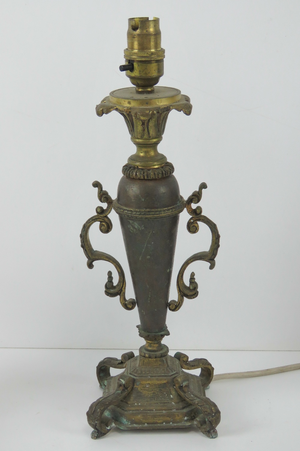 A brass table lamp in the form of an urn