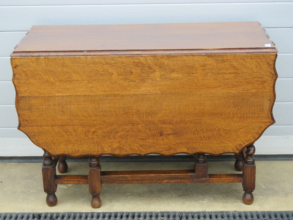 A substantial oak drop leaf table having - Image 2 of 2