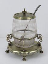 A barrel shaped glass condiment pot havi