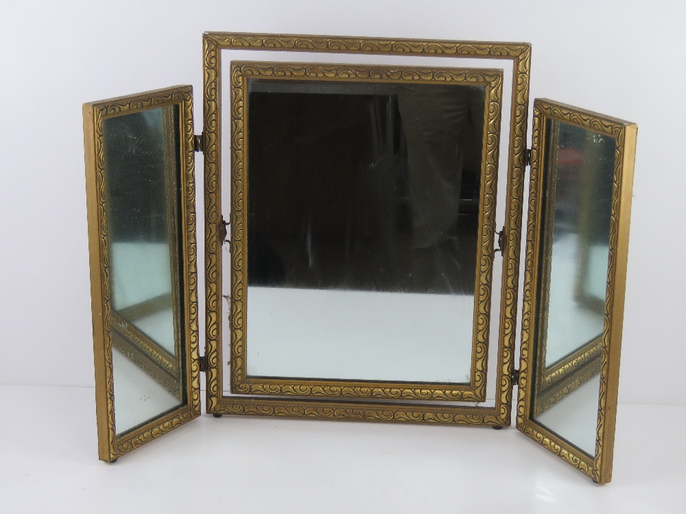 A gold painted tryptic dressing table mi