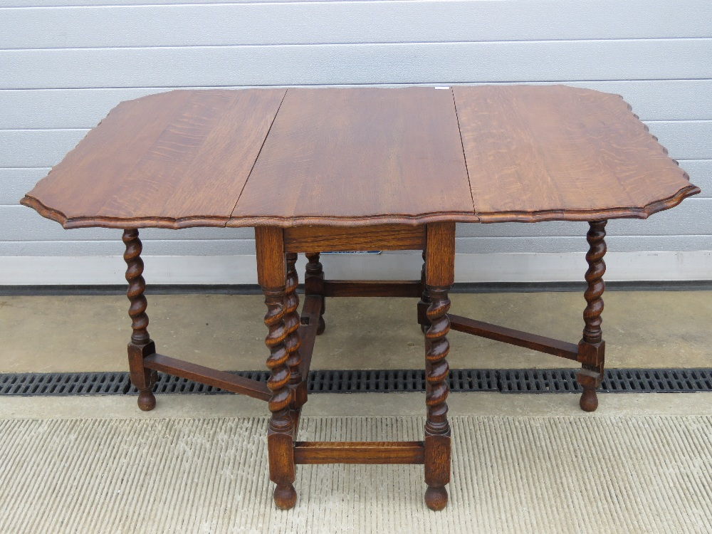 A substantial oak drop leaf table having