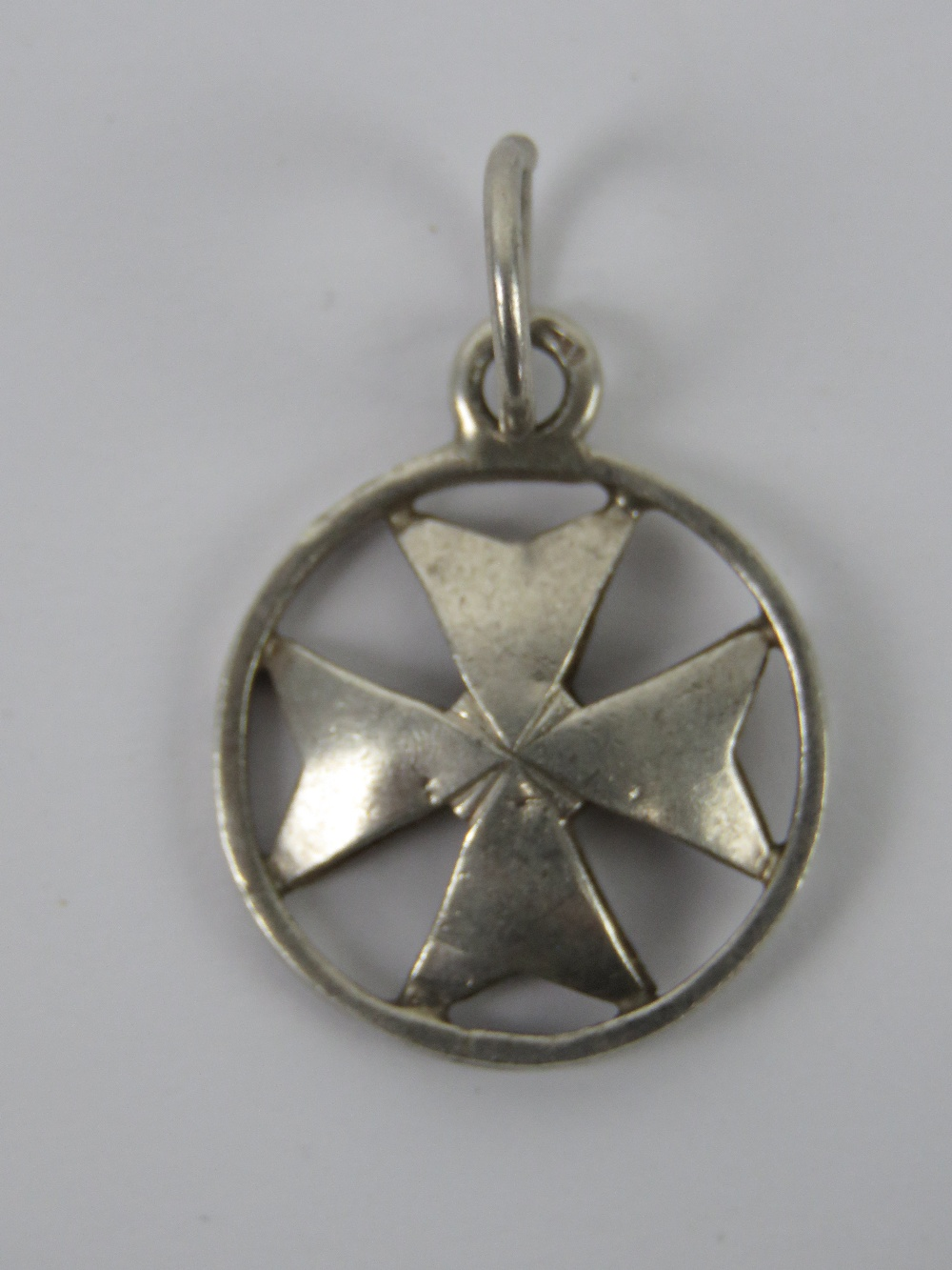 A silver Maltese Cross pendant, having M