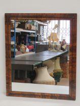 A good stepped walnut framed wall mirror