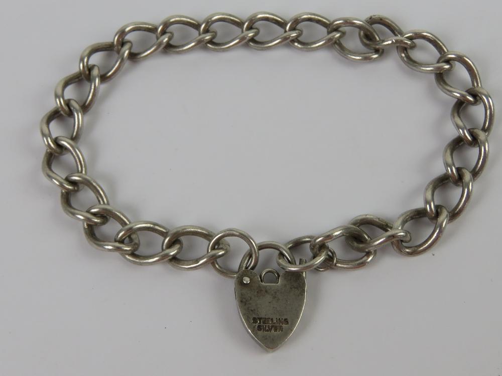 A HM silver curb link chain charm bracel