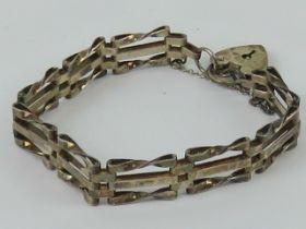 A silver three-bar gate link bracelet ha