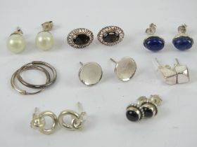 A quantity of assorted pairs of silver e