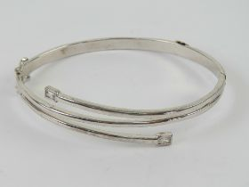 An HM silver hinged bangle having double