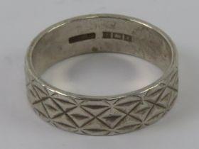 A HM silver ring having continuous engra