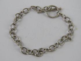 An HM silver charm bracelet having T-bar