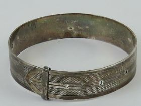 An HM silver bangle in the form of a bel
