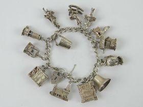 A HM silver charm bracelet with a quanti