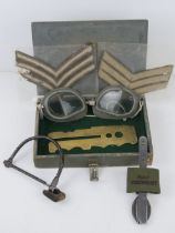 An RAF Officer's small kit box containing cutlery, brass button polishing board, goggles,