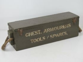 A box containing a British Enfield rifle armourer's kit and breach cover, inc; sling,