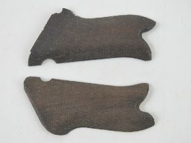 A pair of WWI Luger pistol wooden grips.