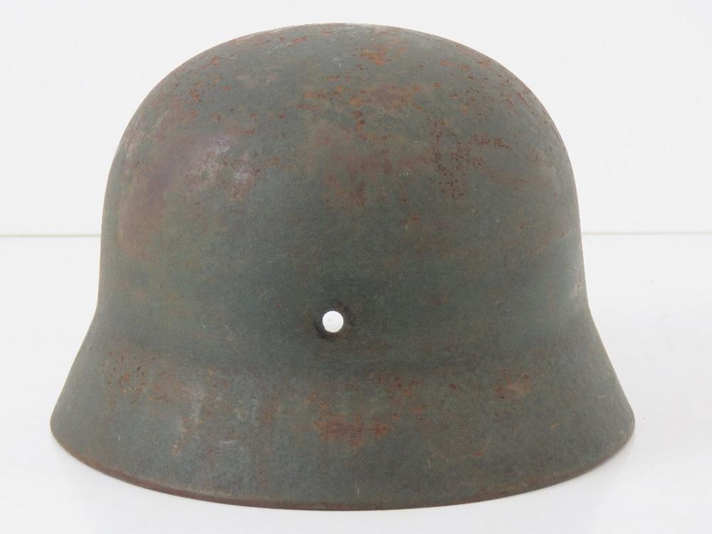 A WWII German helmet, liner deficient. - Image 3 of 4