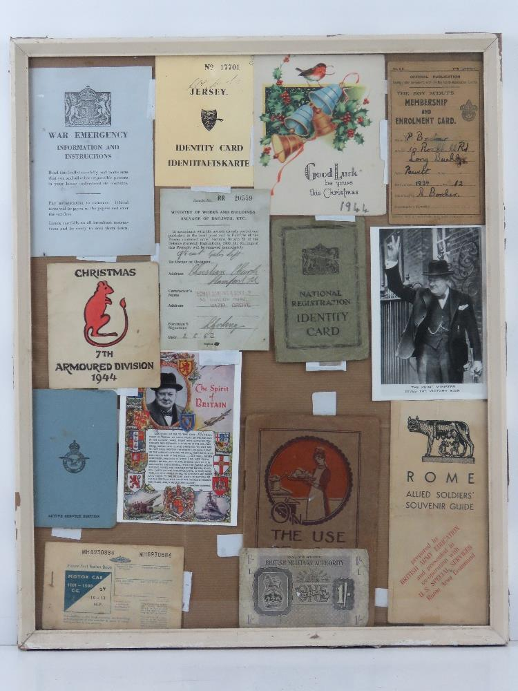 A framed montage of WWII items inc Motorfuel ration book,