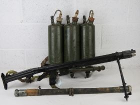 A deactivated LPO-50 flame thrower having moving parts with connector hose and tanks.