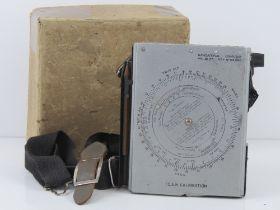 A WWII British navigational computor Mark III in original packaging.