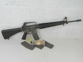 A deactivated US Military Colt manufacture M16A1 5.