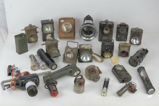A large quantity of assorted lamps and torches inc bike lamps, Air Ministry signal lamp,